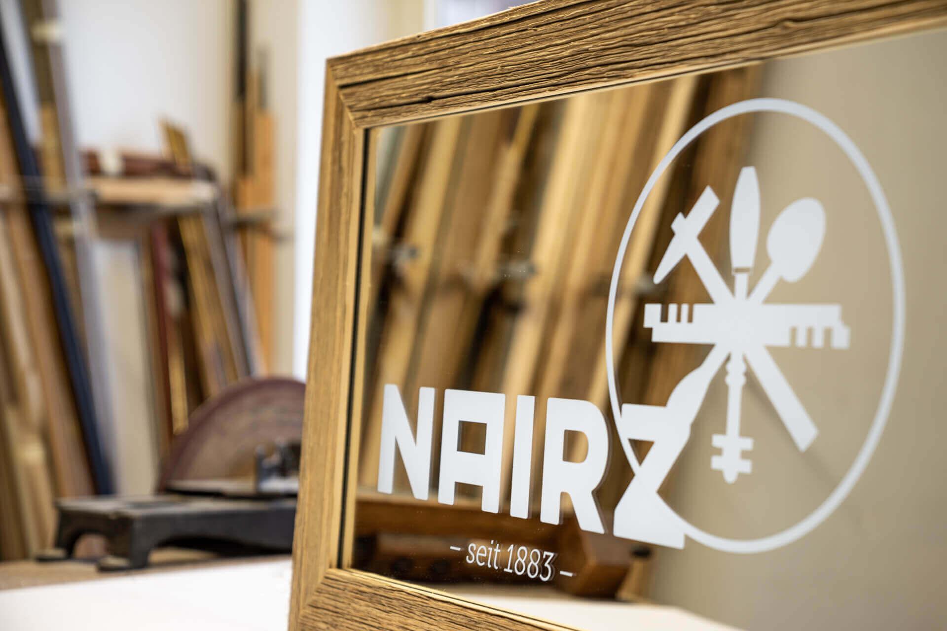 Logodruck auf Spiegel
